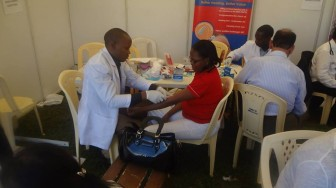 A staff member taking a shot at the medical check up tent